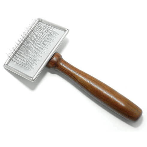 More informations about: Sliker brush for dogs - soft pimples and wooden handle - small model