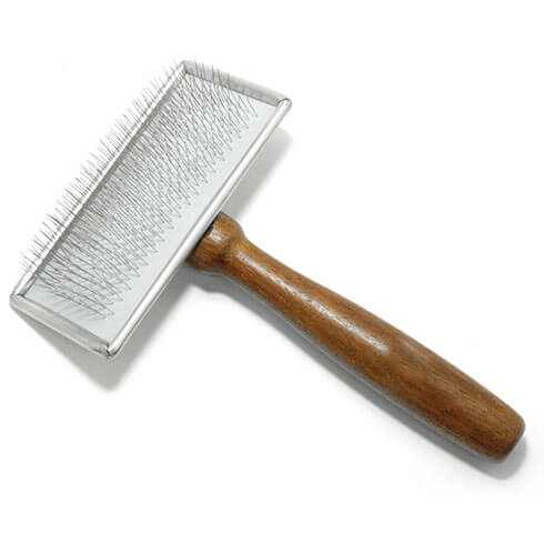 More informations about: Sliker brush for dogs - soft pimples and wooden handle - medium model